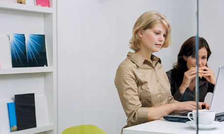 Two young women in an office