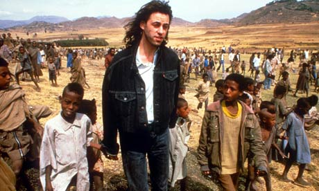 Bob Geldof with children in Africa, 1985.