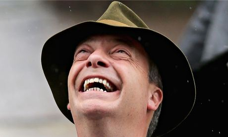 Nigel Farage laughs up at rain