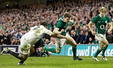 Ireland centre Brian O'Driscoll scores