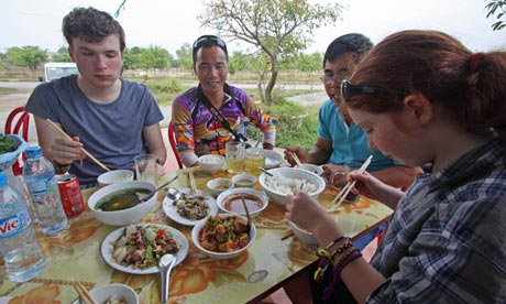 Niall, and Maddy tucking in to Vietnamese cuisine.