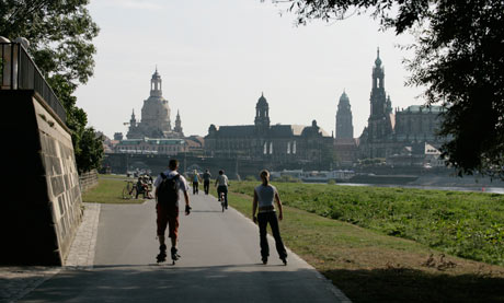Pathway along Elbe river with view of cityscape Dresden, Germany