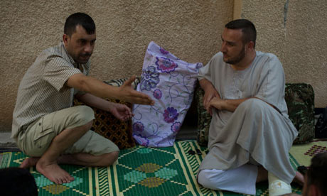Prisoner Barakat, left, and Sheikh Omar, right, in al-Bab.Photograph by Zac Baillie