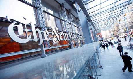 Pedestrians walk past the New York Times headquarters in New York