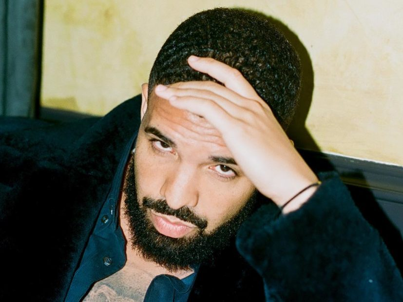 Drake Pops Up With Baby Adonis Tattoo