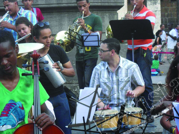Youth musicians practices with Aquino