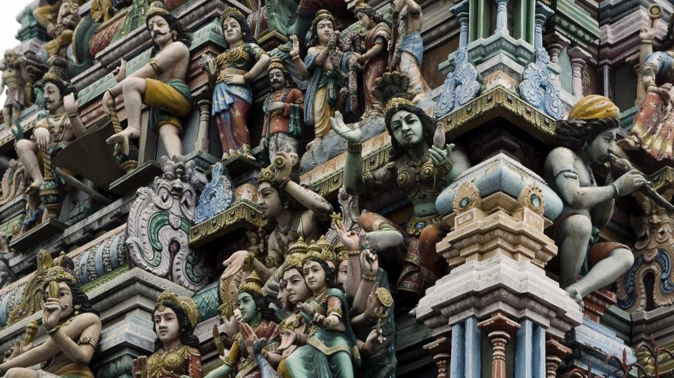 Figures of Hindu gods on the roof of a temple.
