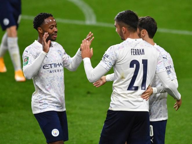 Goalscorers Raheem Sterling and Ferran Torres celebrate