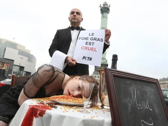 Peta protesting against foie gras production in Paris in 2012 (Getty Images)
