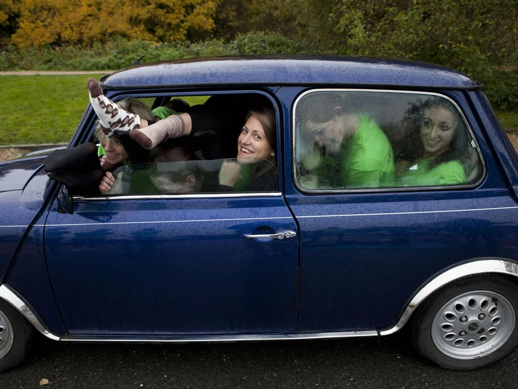 28 Women To Try To Squeeze Into A Mini On Guinness World