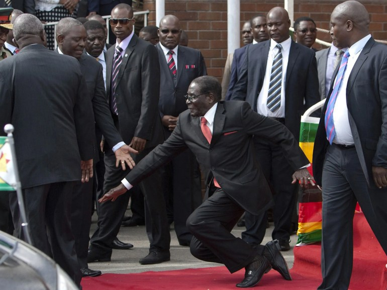 Robert Mugabe falls down stairs, tries to get photographers to delete evidence | The Independent | The Independent