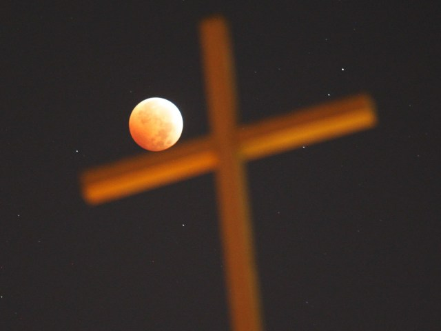"""Minority Christian groups have predicted the world will end later this month – when they say a 'blood moon' will bring about an apocalyptic meteor strike. Scientists say a 'blood moon' will occur on September 28, when the moon passes into the shadow of the earth cast by the Sun (a lunar eclipse) and appears dim and reddish. Some religious leaders believe that because this is the fourth consecutive lunar eclipse since April 2014, it is part of a """"tertrad"""" - which foretells a meteorite destroying earth and the end of time. Experts at Nasa remain unconvinced"""