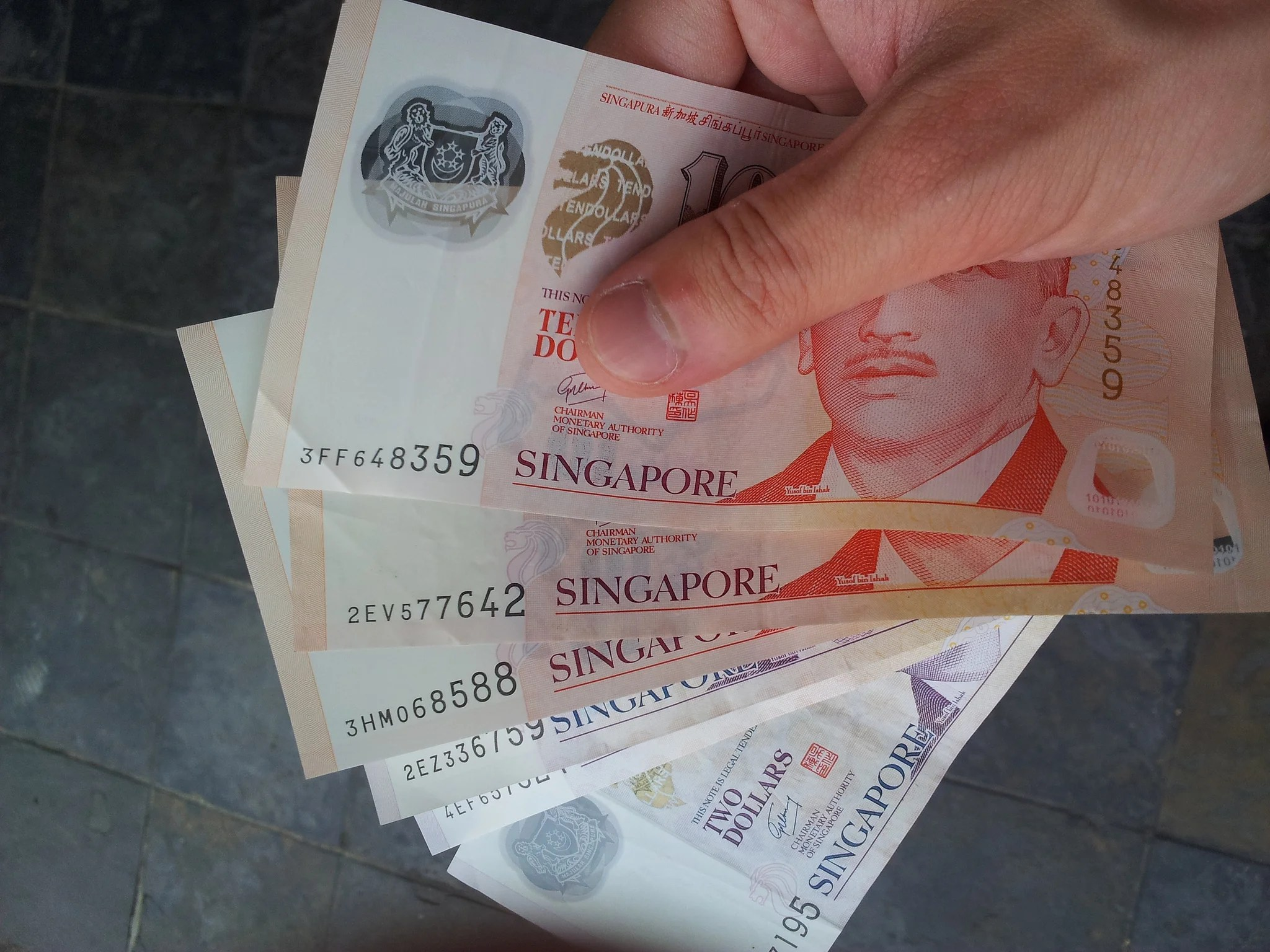 Singapore student finds 30000 in cash in public toilet