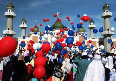 Image result for Muslims celebrate Eid-al-Fitr