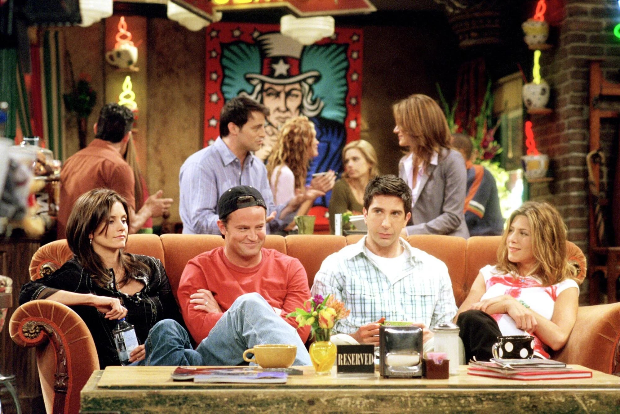 sofa from friends how to decorate a small living room with and loveseat millennials watching on netflix shocked by