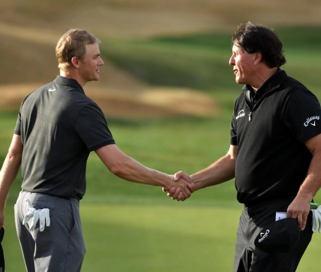 Adam Long And Phil Mickelson Embrace After The Former Wins The Desert Classic