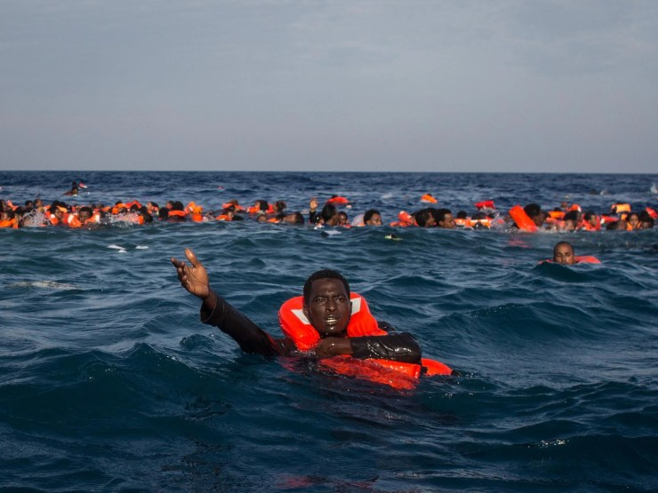 Refugees and migrants swimming and shouting for help from crew members from the Migrant Offshore Aid Station's Phoenix vessel off the coast of Italy, 24 May, 2017