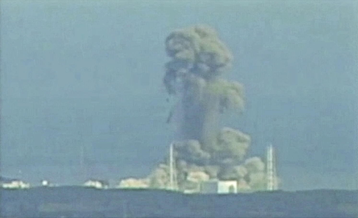Smoke rises from Fukushima Daiichi nuclear power complex in this still image from video footage