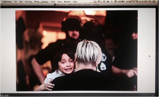 Child crying after mother arrested for jaywalking during Kelly Thomas rally / Photo by Josue Rivas, via OCWeekly.com