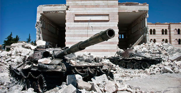 Two destroyed tanks outside of a damaged mosque in Azaz, Syria. Credit: christiaantriebert via Flickr