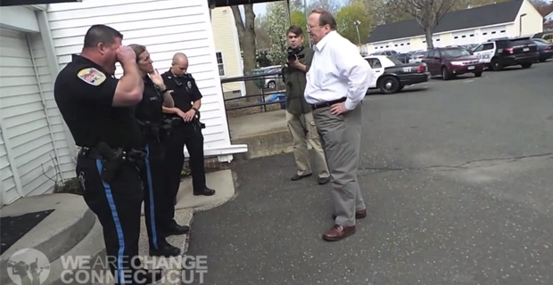 Several police officers were summoned when Halbig attempted to enter the United Way of Newtown. /  Credit: We