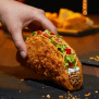 Taco Bell S New Toasted Cheddar Chalupa Has Cheese Baked