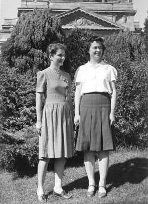 Two 20-something women standing in front of campus building at U. of Washington
