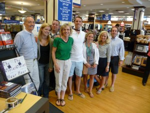 Author and half a dozen or more fans posing in bookstore.