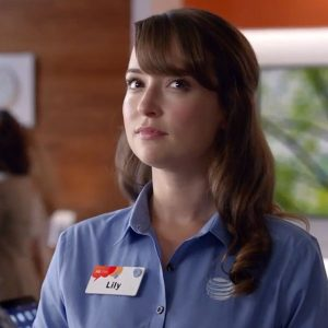 Bust shot of actress in ATT&T commercial with annoyed face- Lookism?