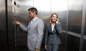 Male and female showing male privilege  in elevators.