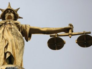 Statue  with Scales of justice for Ending white privilege in crime?