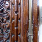 "Doors with ""slave chain"" motifs."