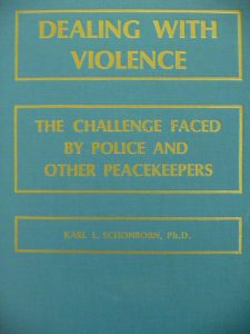 Blue book cover of Dealing with Violence: The challenged faced by police and other peacekeepers.
