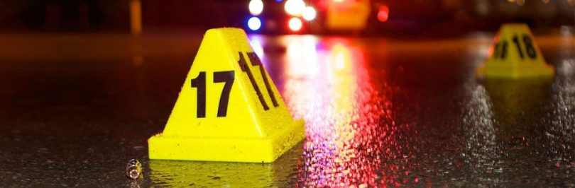 crime scene photo with yellow cone