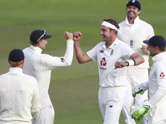 Stuart Broad celebrating with fellow players after taking wickets