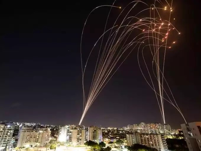Streaks of light are seen as Israels Iron Dome anti-missile system intercepts rockets launched from the Gaza Strip towards Israel, as seen from Ashkelon, Israel.