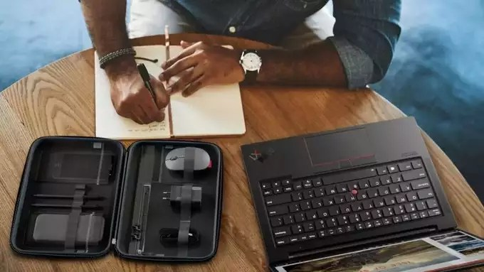 Lenovo-Go-accessories-in-tech-organizer-on-table-with-someone-working-1024x577.