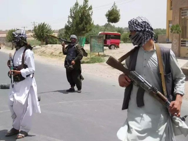 Former Mujahideen hold weapons to support Afghan forces in their fight against Taliban, on the outskirts of Herat province (2).
