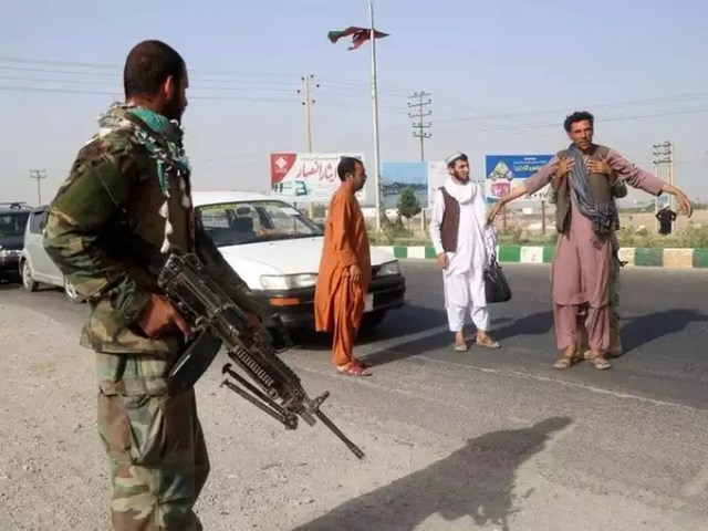 Afghan National Army soldiers keep watch at checkpoint in Guzara district of Herat province.