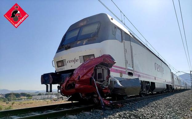 The car has been destroyed after the impact with the train