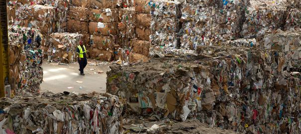 """A worker walking  inside the Recology plant in San francisco on March 23, 2105.  Recology is  an integrated resource recovery company that collects and processes municipal solid waste and reclaim useful materials that would have otherwise been buried in a landfill. It promotes recycling, composting, and other waste-reduction programs to minimize the amount of materials sent to landfills.  Recology is the largest organics compost facility operator by volume in the United States. The name Recology is a combination of the words """"recycle"""" and """"ecology?. (Frederic Neema/Polaris) ///    *** Local Caption *** 05118419  report 3328"""