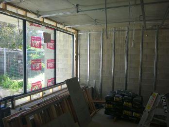 Windows in unit 4, furring channels installed