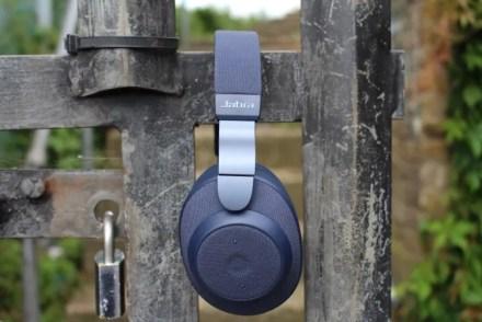 Jabra Elite 85h headphones on a locked gate