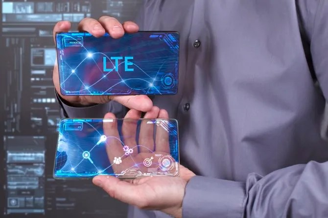 A man presenting a phone using LTE technology