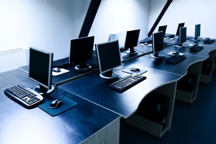 Computer bank with multiple Windows computers on desks