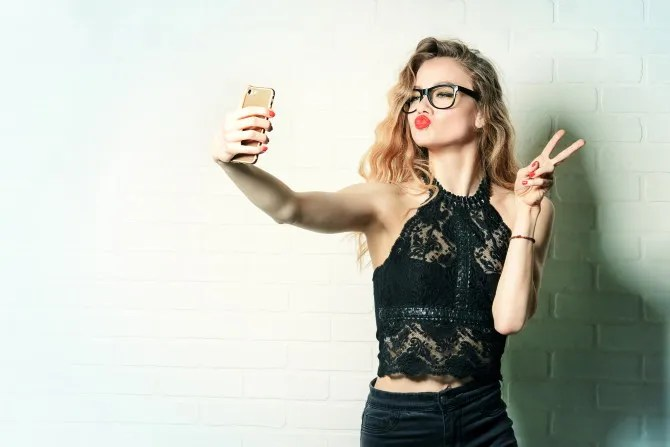 Girl taking an exaggerated selfie