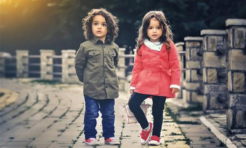 Two kids on stone road