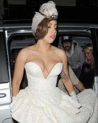 Lady Gaga avoids nipple-slip in low-cut wedding dress at ...