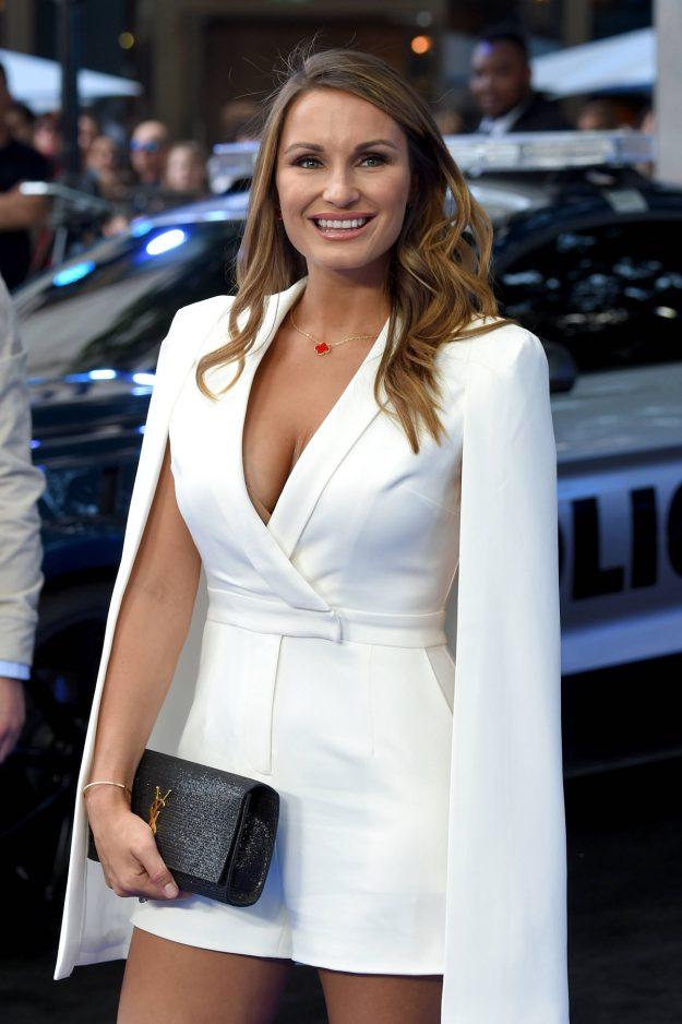 Sam Faiers flaunting her cleavage in a sexy white playsuit