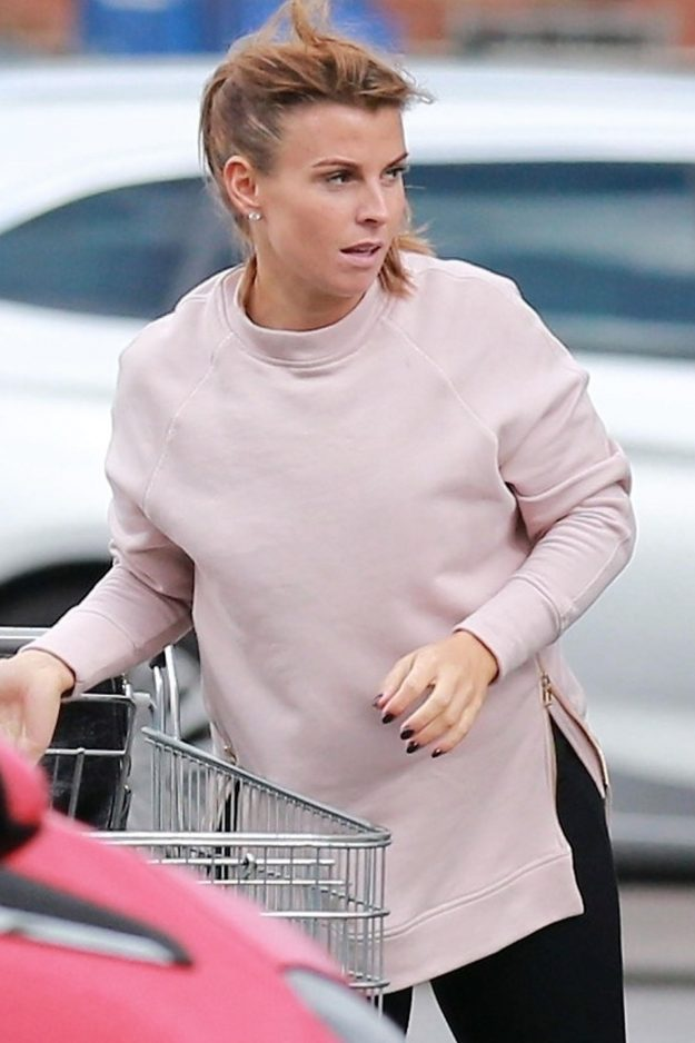 Pregnant Coleen Rooney shows off baby bump as she heads out without
